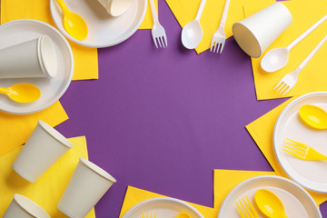 New plastic dishware and space for text on color background. Table setting
