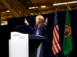 Boeing Executive Vice President Caret holds up two fingers on both hands as she announces Boeing will be delivering two Boeing KC-46 Pegasus aerial refueling tankers to the U.S. Air Force in Everett, Washington
