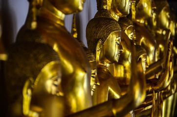 Golden buddha figures in a row