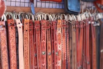 Sales leather belts at the market