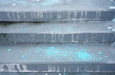 Melting salt on the stair steps in winter season