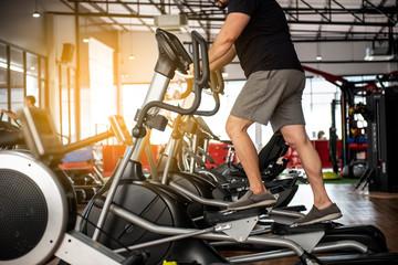 elderly senior sport Man at the gym exercising on the xtrainer machines - Image