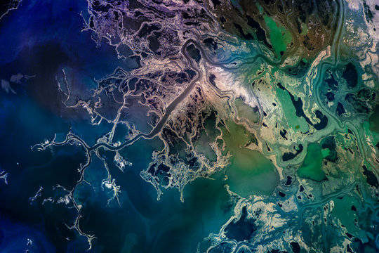 Saskatchewan River Delta, Manitoba, Canada. Satellite view. Colorful collage. Elements of this image are furnished by NASA.