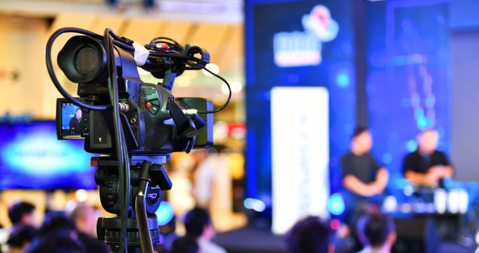 Video recording activity, television cameras in a row broadcasting a live media event.