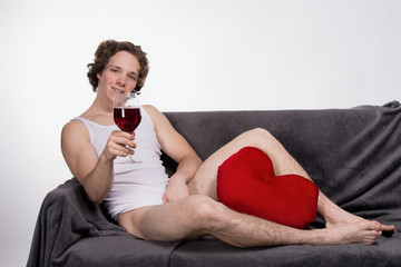 Valentine's Day. Young attractive guy and red wine.