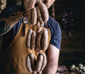 Butcher selling sausages on a string