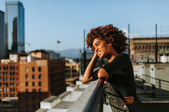 Girl with curly hair at a LA rooftop