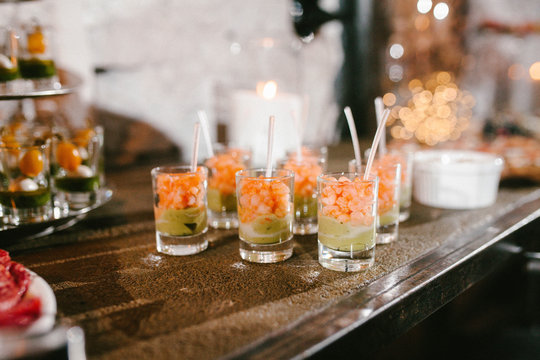 appetizer with shrimp and avocado in a glass, buffet table