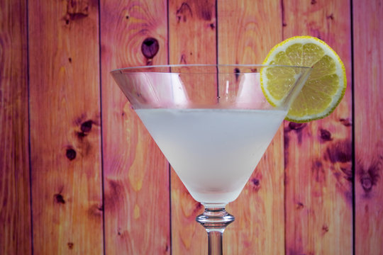 White Lady Cocktail in martini glass decorated slice of lemon