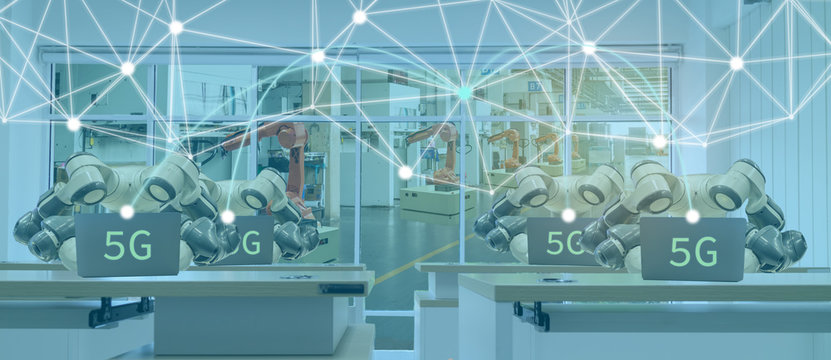 iot smart factory in industry 4.0 robot technology concept, engineer using futuristic technology with 5G to control ,monitor, management robotic to improve efficiency, product, quality, reduce cost