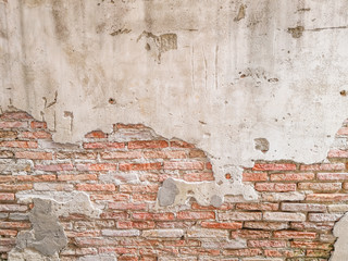 Old brick wall in antiquity and was damaged