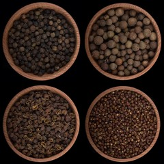 set of peppercorns isolated on black background