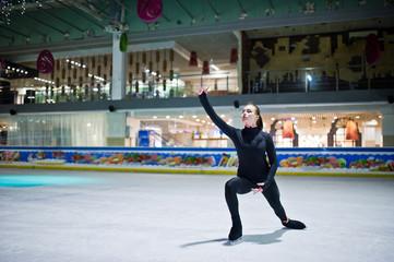Figure skater woman at ice skating rink.