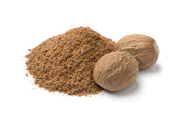 Fototapeta Heap of ground nutmeg and whole nutmeg seeds obraz