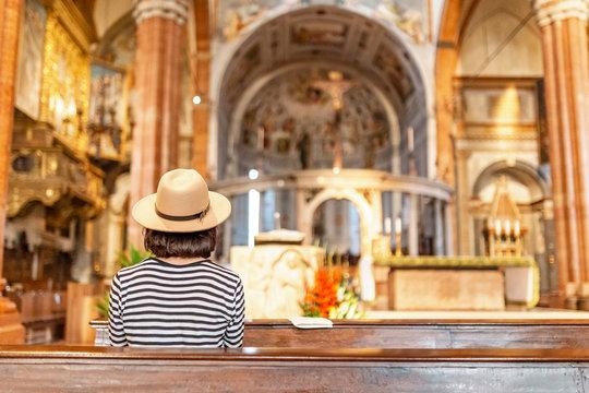 Asian Woman praying in church
