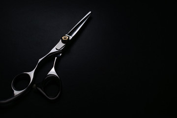 professional scissors on black background Wall mural