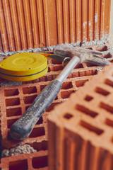 Construction tool on a brick.