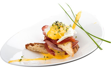 Breakfast. Benedictine eggs with tomatoes on toast. On white background