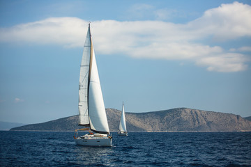 Wall Mural - Sailing luxury yacht boats on the Aegean Sea.