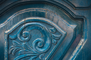 close up ornament of old  blue carving door