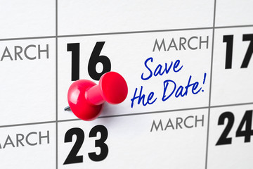 Wall calendar with a red pin - March 16