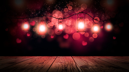Wooden table and pink blurred background with highlights and flashlights, romantic night background.