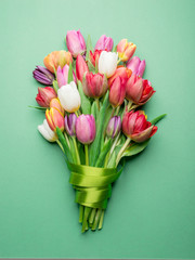Colorful bouquet of tulips on white background.