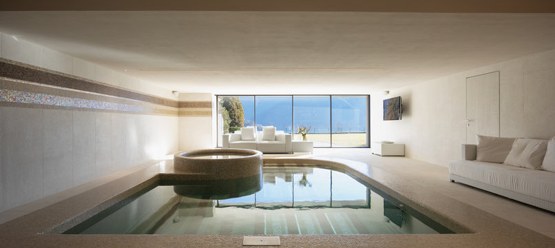 Indoor pool of private villa with lake view and bar area