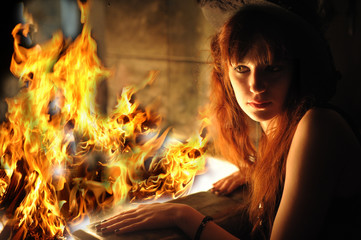 portrait of a red-haired girl by the fire in the fireplace