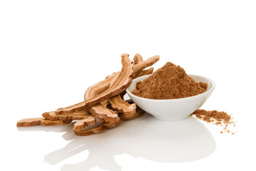 Healthy dry reishi mushroom and powder.