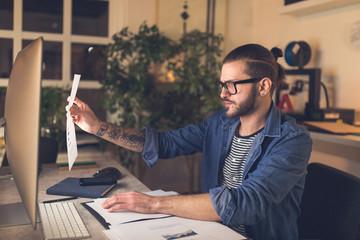 Freelancer Examining Statistics Charts