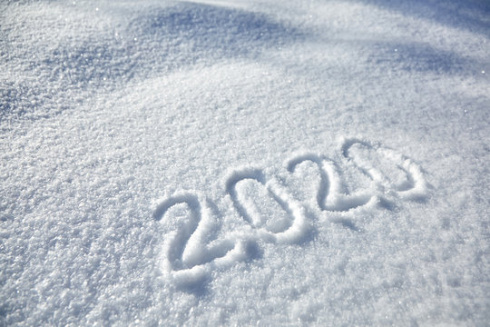 winter inscription 2020 New Year background, text on snow surface