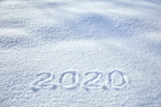 Inscription date 2020 New Year winter background, text on snow surface