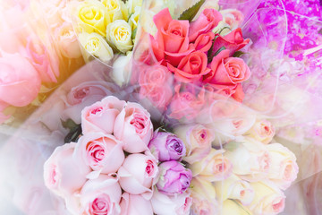 Blurred colorful bouques rose flowers blossom in fresh flower shop background with vintage filter.