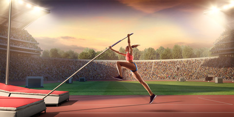 Fototapeta Young female pole vault athlete with pole bar. Women in sport clothes at athletic sport track in professional stadium obraz