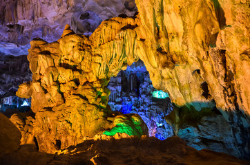 Blue and yellow lights in cave in Vietnam / Ha Long