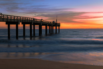 Sunrise over the Atlantic Ocean at the St. Augustine Beach Pier in St. Augustine, Florida