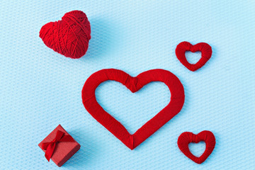 Red hearts and ring on a blue background. Valentine's Day. Valentines day greeting card. An offer of marriage. Engagement