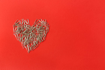 Heart on a red background. Valentine's Day. Valentines day greeting card. Heart of paper clips. Stationery