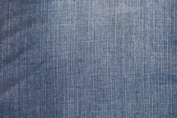 blue denim jeans with wrinkle texture background .
