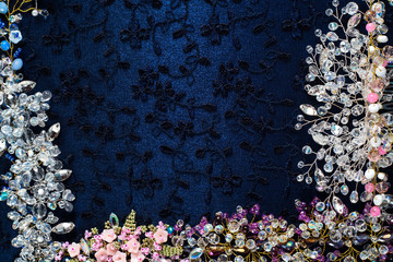 Beautiful shiny background. Crystals, beads, wire, twigs, wedding accessories collected on dark fabric