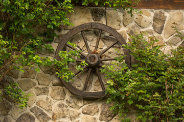 Old wooden wheel on the wall