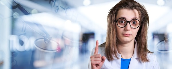 Young female scientist standing  on background