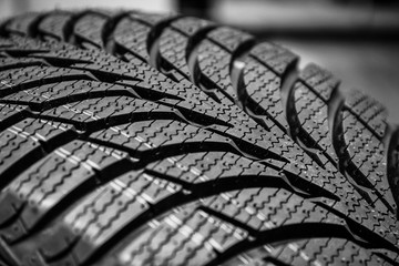 black stylish new tire for cars on wheels