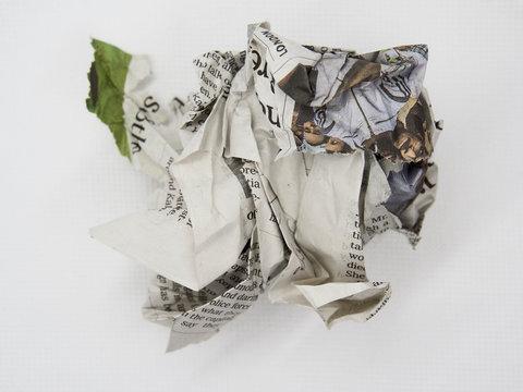 torn and crumpled newspaper