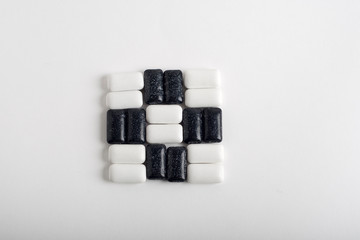 black and white chewing gum on white background