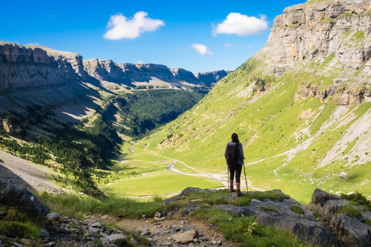 Hiker looking towards the valley of the Ordesa National Park on a sunny day.  Spain