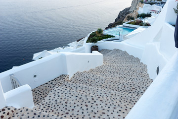 Stairs to the aegean sea in Santorini village of Oia, Greece