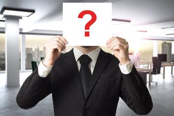 businessman in modern office hides face behind sign question mark 3D Illustration