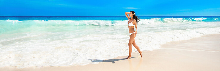 Happy Woman on the Beach of Ocean. Summer Vacation